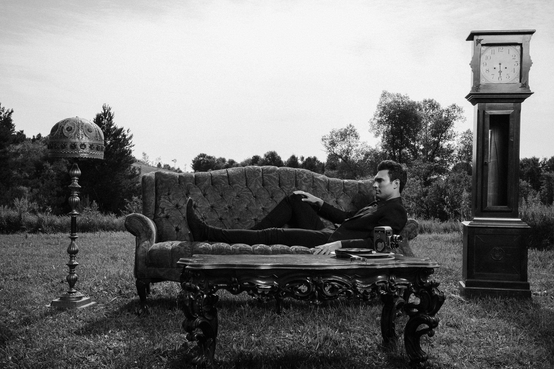 Peter Serrado on laying on sofa